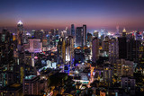 The cityscape is colorful in the night in Thailand.