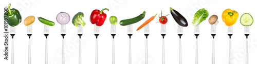 Keuken foto achterwand Verse groenten row of tasty vegetables on forks isolated on white background