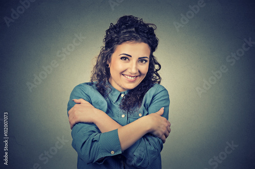 confident smiling woman holding hugging herself Poster