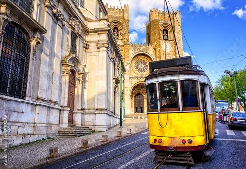 Historical yellow tram in front of the Lisbon cathedral, Lisbon, Poster