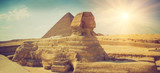 Panoramic view of the full profile of the Great Sphinx with the pyramid in the background in Giza. - 102019051