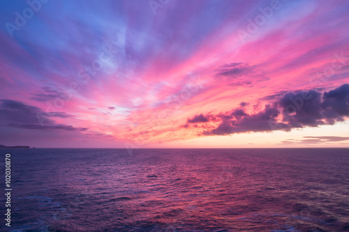Colorful sunrise over the ocean Poster