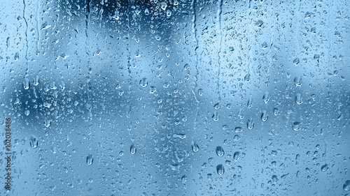 Foto Murales Raindrops on the window. Blue tone