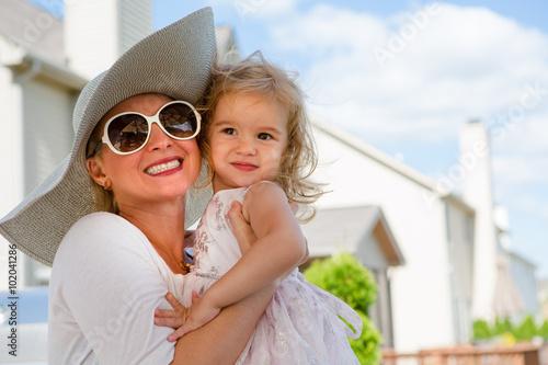 Mother and Daughter Hugging Outdoors in Summer © Ozgur Coskun