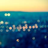 Fototapety city blurring lights abstract circular bokeh on toned blue backg