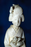Japanese woman in traditional dress made of ivory
