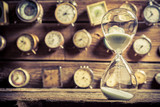Fototapety Vintage hourglass on the background of clocks