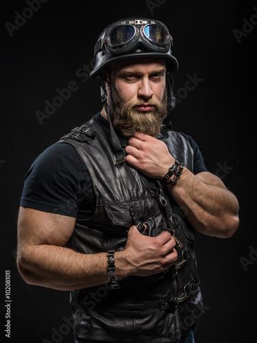 Zdjęcia Portrait Handsome Bearded Biker Man in Leather Jacket and Helmet