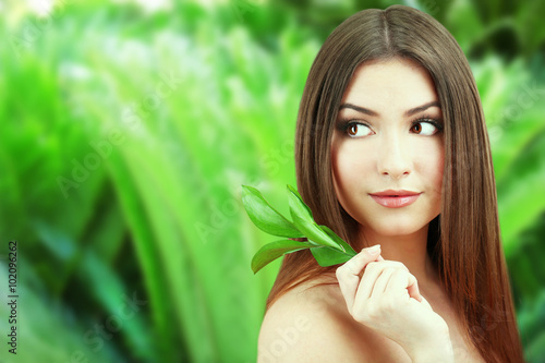 canvas print picture Beautiful young woman on green natural background