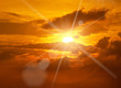 Beautiful peaceful sunset - bright sun, yellow beams