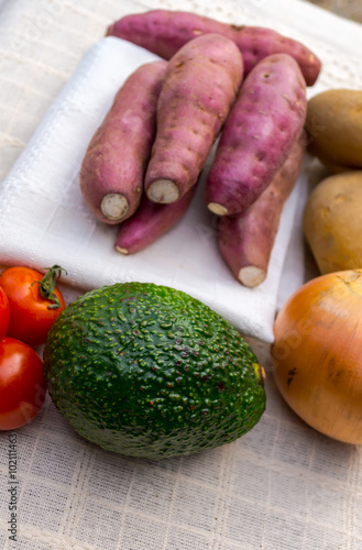 Poster Japanese sweet potato with avocado and tomato