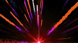 Seamless Animation of abstract colorful red light fireball and fireworks shooting into the sky and with shiny particle trail element in black background in 4k ultra HD loop