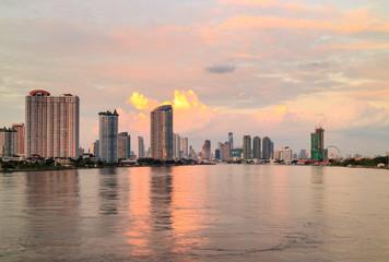 Chao phraya river and Bangkok cityscape at twilight