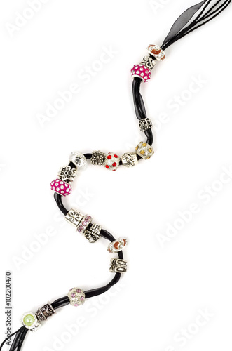 Poster Modern fashion jewellery with charms and pendants on white background