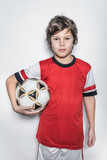 Soccer Player Boy in Red Uniform With Ball
