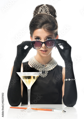 Girl in sun glasses, looks like a movie star, drinking martinis Poster