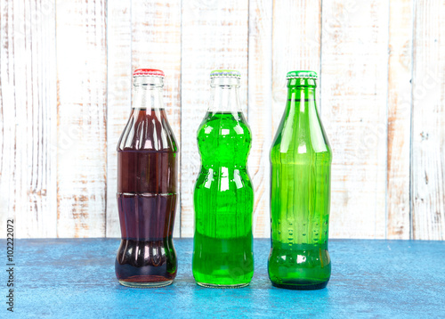 Poster variety of soda bottle on the wooden background