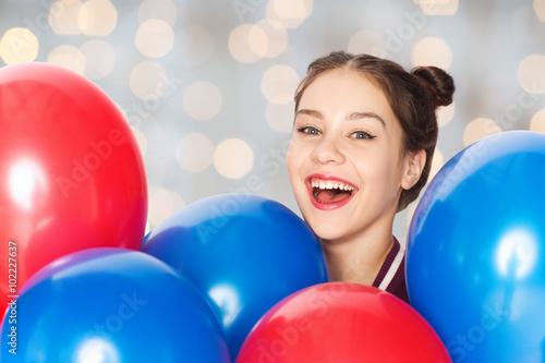 Poster happy teenage girl with helium balloons