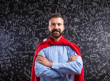 Fototapety Teacher in red cape against big blackboard with mathematical sym