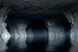 underground river in a dark stone cave