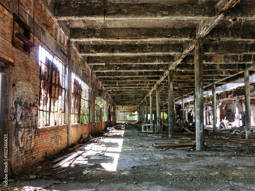Keuken foto achterwand Oude verlaten gebouwen Crumbling abandoned factory warehouse with broken windows, landscape photo
