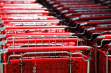 close up on stacking shopping carts in rows