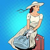 Fototapety The girl passenger Luggage