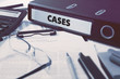 Cases - Ring Binder on Office Desktop with Office Supplies. Business Concept on Blurred Background. Toned Illustration.