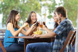 Group of happy friends toasting