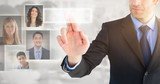 Composite image of businessman pointing these fingers at camera