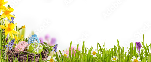 Decorated Easter eggs in a spring meadow - 102431852