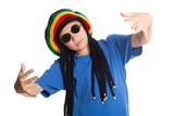 European boy in a cap with dreadlocks sings rap