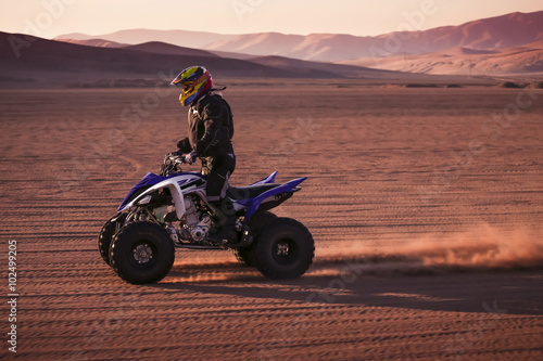 obraz PCV Quad racing in the desert