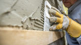 Closeup of workman carefully positioning an ornamental tile in a