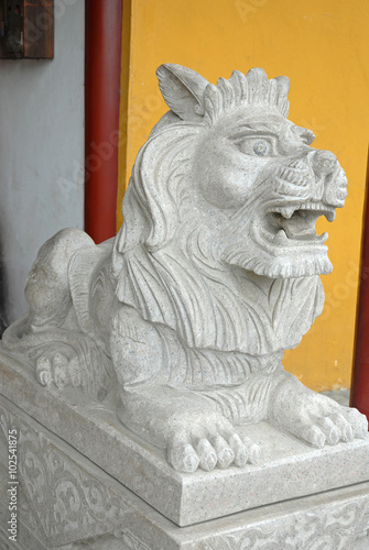 Lion statue at Xitang ancient town. Poster