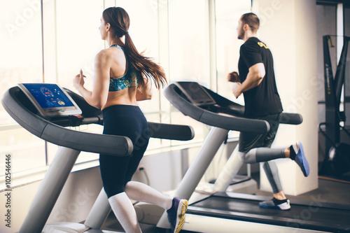 Couple running on treadmill