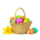 Fototapety Easter basket with colorful eggs and daffodils on a white background
