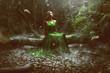 Obrazy na płótnie, fototapety, zdjęcia, fotoobrazy drukowane : Woman wears a green dress in the forest