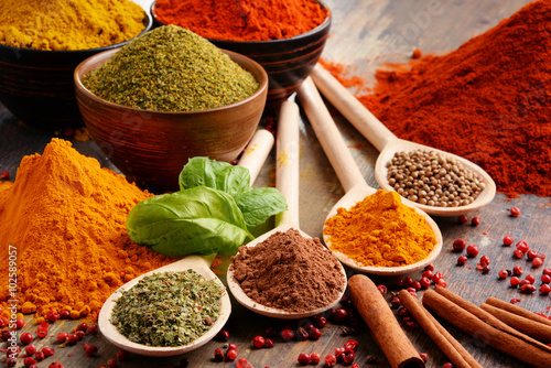 Poster Variety of spices on kitchen table