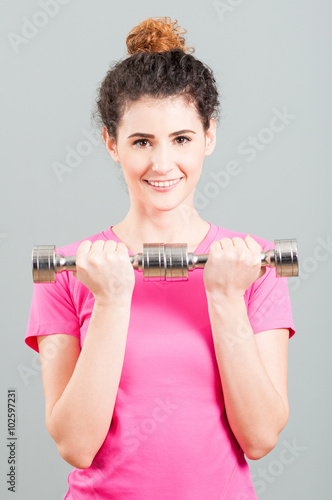 Tuinposter Gymnastiek Yound woman doing weight training with dumbbells