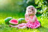 Fototapety Little girl eating watermelon