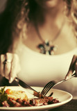 Woman dining at restaurant