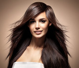 Fototapety Fashion model with long straight hair.