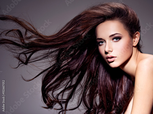 Poster, Tablou Portrait of the beautiful  young woman with long brown  hair