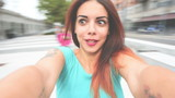 Young handsome caucasian reddish woman running in circles, looking in camera smiling – fun, happiness, carefree concept