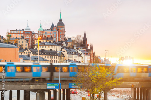 Poster Stockholm, view of buildings and train at dusk