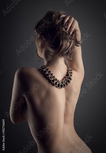 Sexy young woman back studio shot
