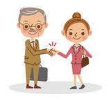 握手をするビジネスマン(シニア男性と若い女性)