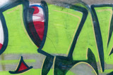 Detail of a graffiti art on a wall. Wall painted in green and re