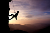 Silhouette of Rock Climber at Sunset - 102786052